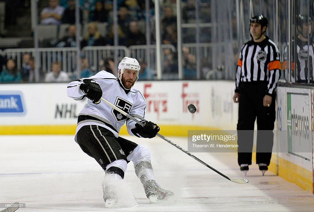 Rob Scuderi #7 of the Los Angeles Kings skates with the puck against the San Jose Sharks in the first period in Game Four of the Western Conference Semifinals during the 2013 NHL Stanley Cup Playoffs at HP Pavilion on May 21, 2013 in San Jose, California. The Sharks defeated the Kings 2-1.