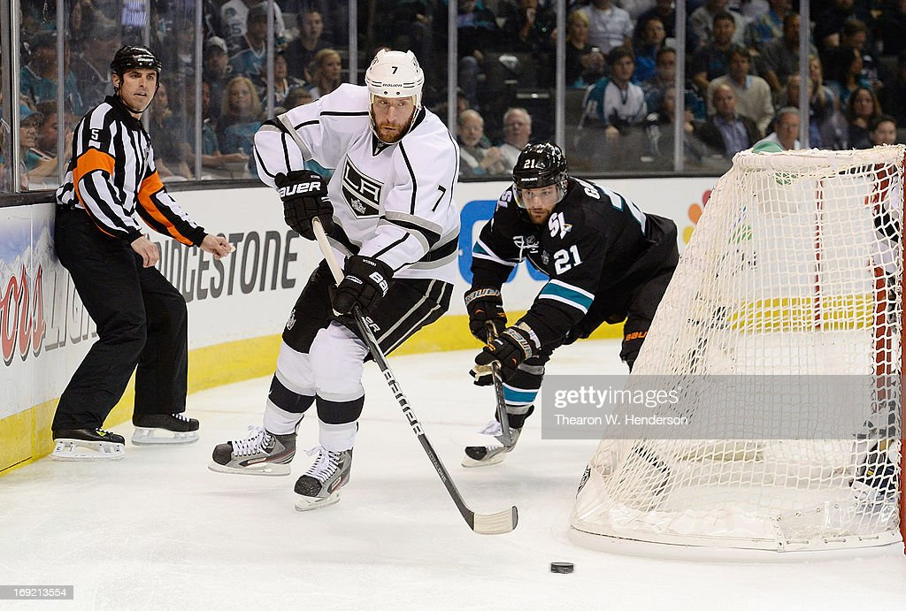 Rob Scuderi #7 of the Los Angeles Kings skates with the puck ahead of TJ Galiardi #21 of the San Jose Sharks in the second period in Game Four of the Western Conference Semifinals during the 2013 NHL Stanley Cup Playoffs at HP Pavilion on May 21, 2013 in San Jose, California.