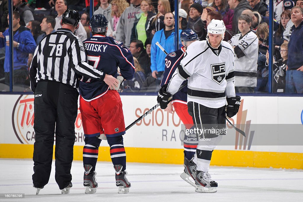 Rob Scuderi #7 of the Los Angeles Kings taps Brandon Dubinsky #17 of the Columbus Blue Jackets on the knee with his stick as he goes to the bench following an apparent injury Scuderi suffered after being checked in to the boards by Dubinsky in the second period on February 5, 2013 at Nationwide Arena in Columbus, Ohio. Dubinsky was given a boarding major penalty and game misconduct for the hit and Scuderi returned to the game.