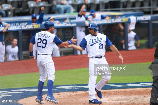 Rob Segedin of Italy celebrates after scoring in the bottom of the third inning during the World Baseball Classic Pool D Game 3 between Venezuela and...