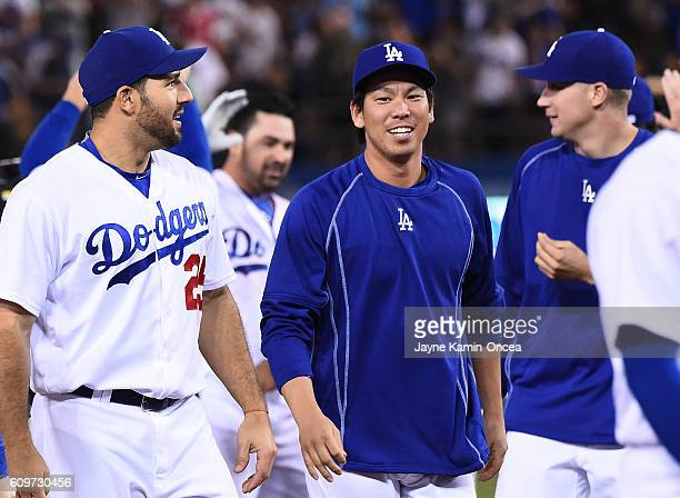 Rob Segedin of the Los Angeles Dodgers and Kenta Maeda walk off the field after the game against the San Francisco Giants at Dodger Stadium on...