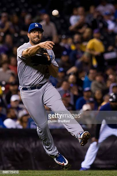 Rob Segedin of the Los Angeles Dodgers forces out a baserunner in the fifth inning of a game against the Colorado Rockies at Coors Field on August 29...