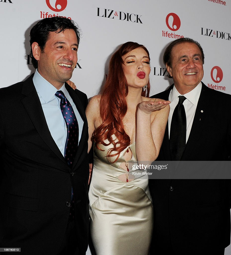 Rob Sharenow, EVP Programming, Lifetime, actress <a gi-track='captionPersonalityLinkClicked' href=/galleries/search?phrase=Lindsay+Lohan&family=editorial&specificpeople=171623 ng-click='$event.stopPropagation()'>Lindsay Lohan</a> and producer Larry Thompson arrive at a party to celebrate Lifetime's 'Liz & Dick' at the Beverly Hills Hotel on November 20, 2012 in Beverly Hills, California.