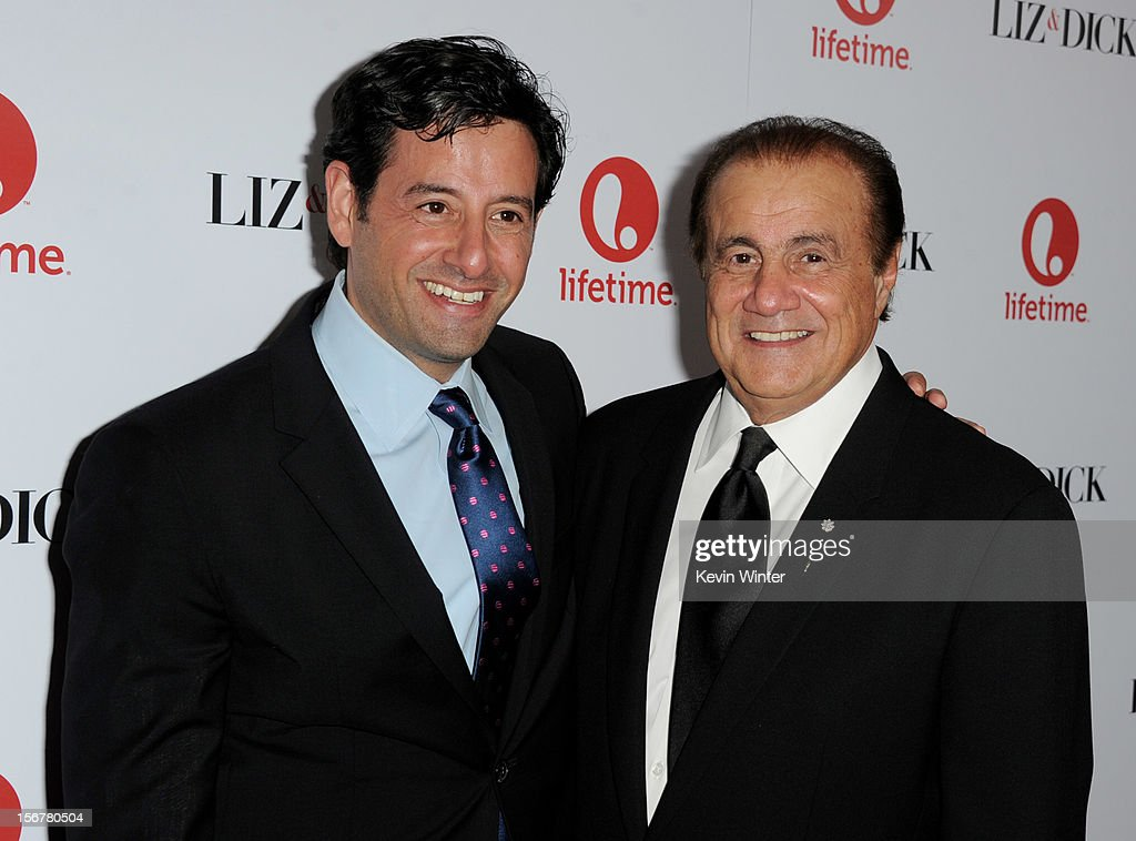 Rob Sharenow, EVP Programming, Lifetime (L) and producer Larry Thompson arrive at a party to celebrate Lifetime's 'Liz & Dick' at the Beverly Hills Hotel on November 20, 2012 in Beverly Hills, California.