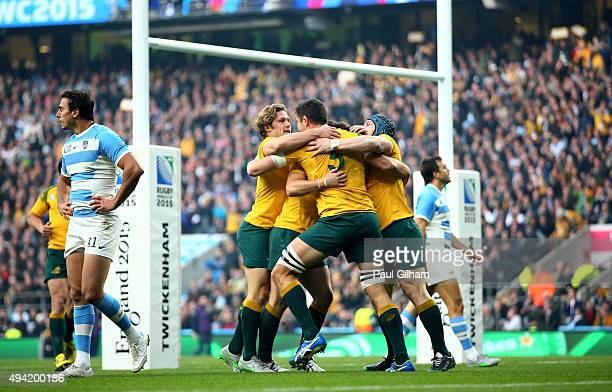 Rob Simmons of Australia celebrates with teammates after scoring the opening try during the 2015 Rugby World Cup Semi Final match between Argentina...