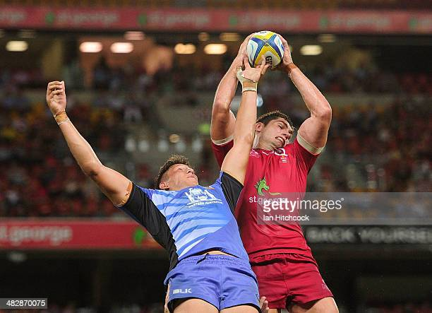 Rob Simmons of the Reds contests a line out with Adam Coleman of the Force during the round eight Super Rugby match between the Reds and the Force at...