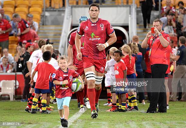 Rob Simmons of the Reds leads his team out onto the field of play before the round two Super Rugby match between the Reds and the Force at Suncorp...