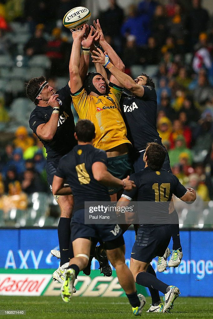 Rob Simmons of the Wallabies contests for the ball against Angentinian players during The Rugby Championship match between the Australian Wallabies and Argentina at Patersons Stadium on September 14, 2013 in Perth, Australia.