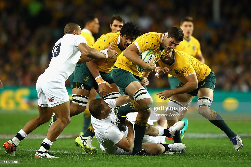 <a gi-track='captionPersonalityLinkClicked' href=/galleries/search?phrase=Rob+Simmons+-+Rugby+Player&family=editorial&specificpeople=11355817 ng-click='$event.stopPropagation()'>Rob Simmons</a> of the Wallabies is tackled during the International Test match between the Australian Wallabies and England at Allianz Stadium on June 25, 2016 in Sydney, Australia.