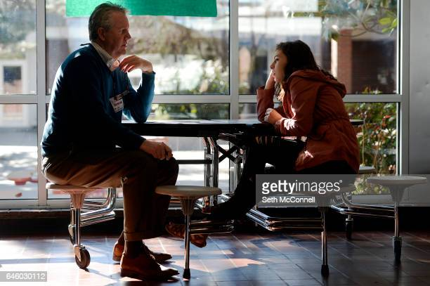 Rob Tallmadge talks with Jenny Arriaga during a mentoring session at Jefferson High School in Edgewater Colorado on February 22 2017 Goodwill Youth...