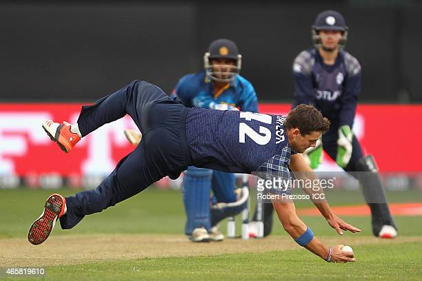 Rob Taylor of Scotland fields the ball off his own bowling during the 2015 Cricket World Cup match between Sri Lanka and Scotland at Bellerive Oval...