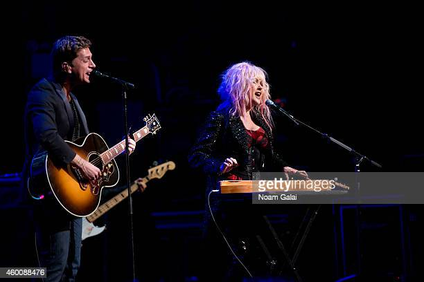 Rob Thomas and Cyndi Lauper perform during the 4th Annual 'Home For The Holidays' Benefit Concert at Beacon Theatre on December 6 2014 in New York...