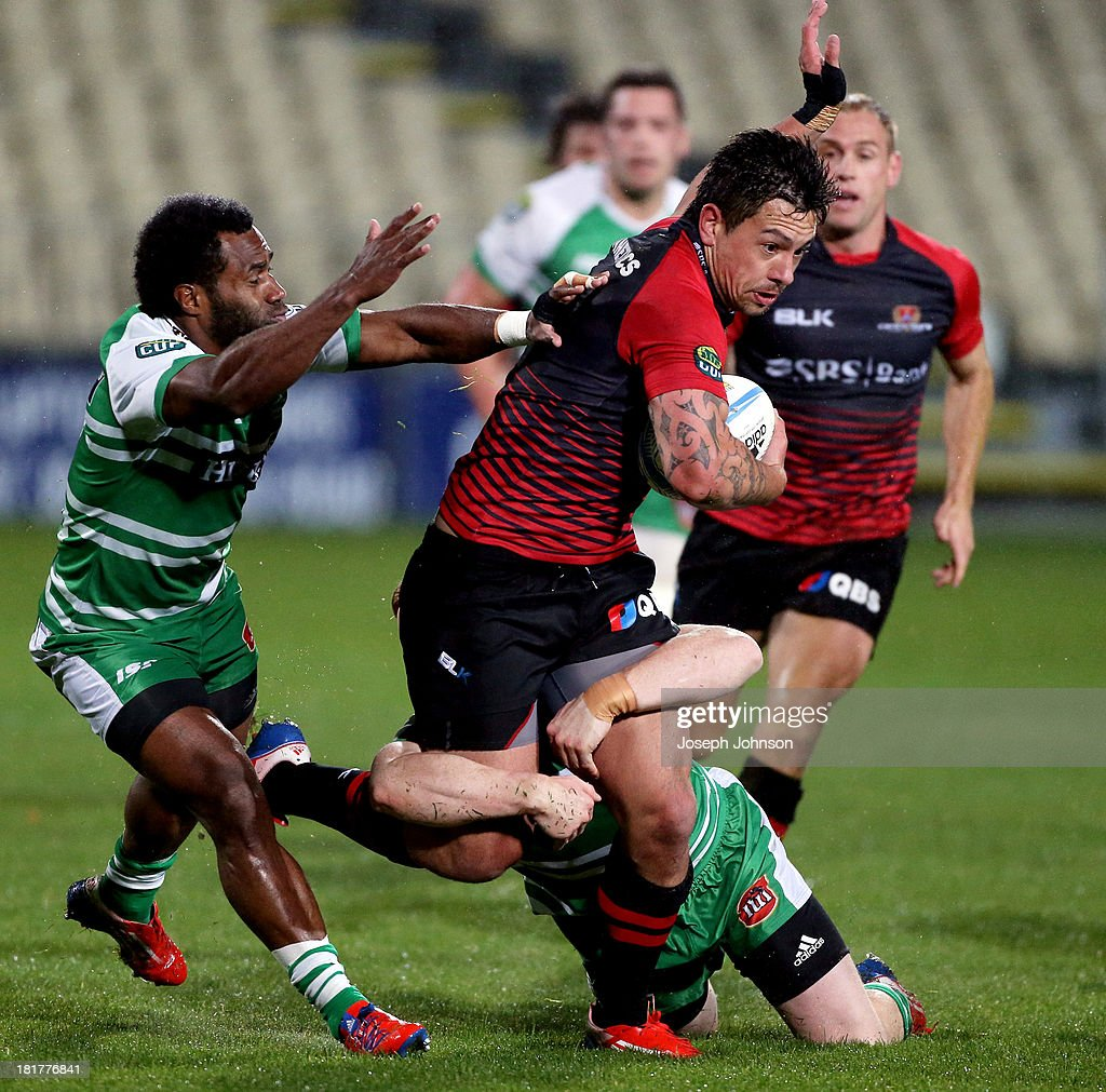 Rob Thompson of Canterbury is tackled by Hamish Northcote and Tamasi Cama of Manawatu during the round 7 ITM Cup match between Canterbury and Manawatu at AMI Stadium on September 25, 2013 in Christchurch, New Zealand.