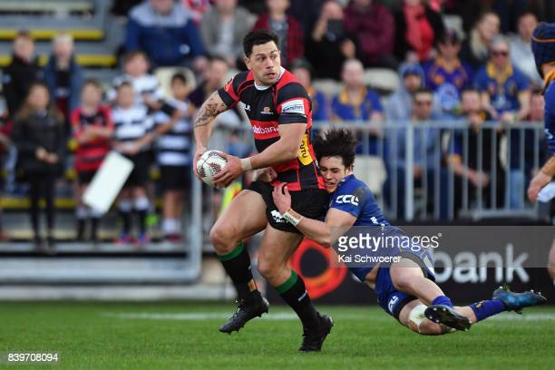 Rob Thompson of Canterbury is tackled by Jonathan Ruru of Otago during the round two Mitre 10 Cup match between Canterbury and Otago on August 27...