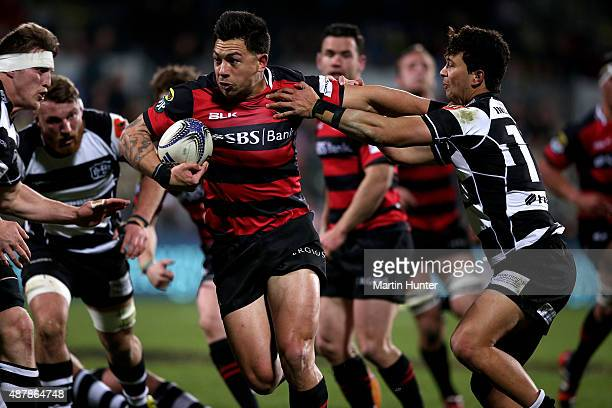 Rob Thompson of Canterbury pushes off the tackle of Jonah Lowe of Hawkes Bay during the round five ITM Cup match between Canterbury and Hawkes Bay at...