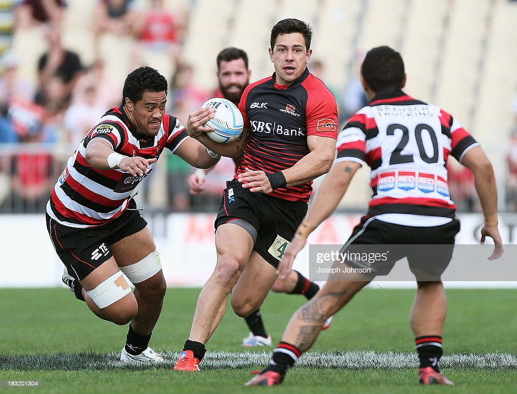 Rob Thompson of Canterbury runs in space with the ball during the round eight ITM Cup match between Cantebury and Counties Manukau at AMI Stadium on October 6, 2013 in Christchurch, New Zealand.