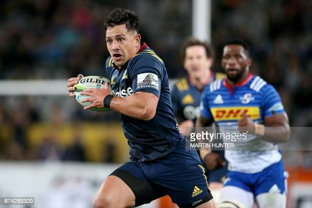 Rob Thompson of the Otago Highlanders breaks through the defence of the Western Stormers to score a try during the Super Rugby match between the...