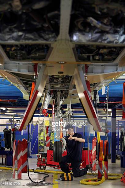 Rob Tomlinson an apprentice craft fitter works on the landing gear of a BAE Eurofighter Typhoon jet in the final assembly hanger at the BAE Systems...