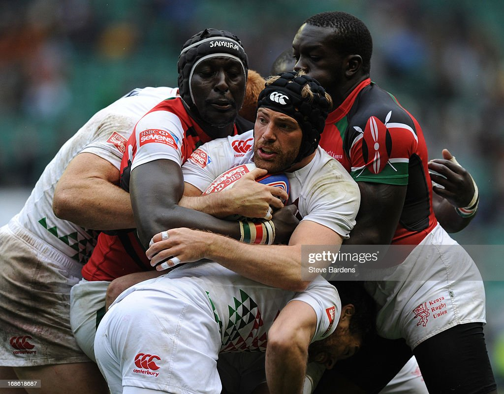Rob Vickerman of England is tackled by the Kenyan defence on day two of the Marriott London Sevens, the final round of the HSBC Sevens World Series at Twickenham Stadium on May 12, 2013 in London, England.