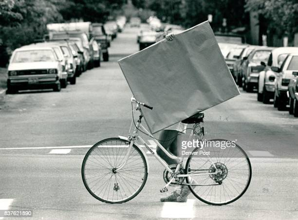 Rob Weil a local artist used his bike to help transport matte board which he purchased at a downtown art supply store back to his home on...