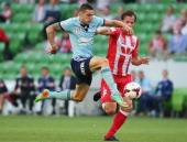 Rob Wielaert of the Heart and Corey Gameiro of Sydney FC compete for the ball during the round 17 ALeague match between Melbourne Heart and Sydney FC...