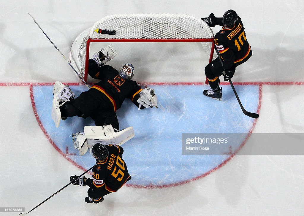 <a gi-track='captionPersonalityLinkClicked' href=/galleries/search?phrase=Rob+Zepp&family=editorial&specificpeople=3121630 ng-click='$event.stopPropagation()'>Rob Zepp</a> (C), goaltender of Germany lies on the ice during the IIHF World Championship group H match between Finland and Germany at Hartwall Areena on May 3, 2013 in Helsinki, Finland.
