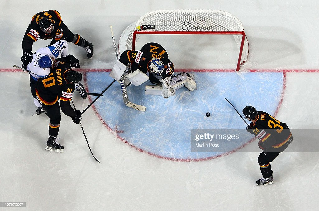 <a gi-track='captionPersonalityLinkClicked' href=/galleries/search?phrase=Rob+Zepp&family=editorial&specificpeople=3121630 ng-click='$event.stopPropagation()'>Rob Zepp</a> (C), goaltender of Germany makes a save during the IIHF World Championship group H match between Finland and Germany at Hartwall Areena on May 3, 2013 in Helsinki, Finland.
