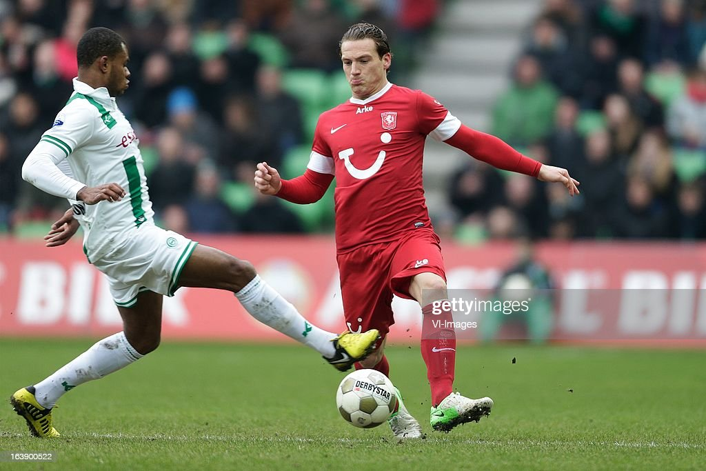 Robbert Schilder of FC Twente (R) Leandro Bacuna of FC Groningen (L) during the Dutch Eredivisie match between FC Groningen and FC Twente at the Euroborg Stadium on march 17, 2013 in Groningen, The Netherlands