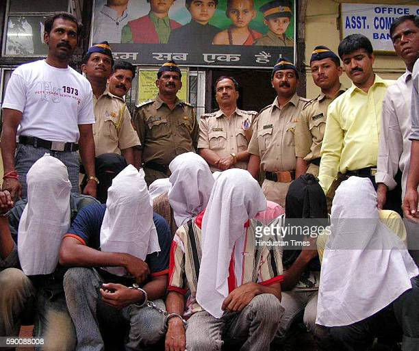 Robbery Juhu police officers with 9 robbers they caught near Holiday Inn Hotel Juhu These robbers came for robbery at Citibank Juhu branch on Thursday