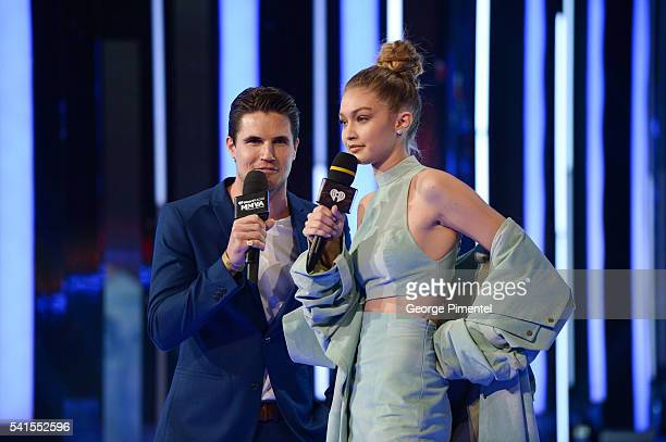 Robbie Amell and Gigi Hadid present at the 2016 iHeartRADIO MuchMusic Video Awards at MuchMusic HQ on June 19 2016 in Toronto Canada