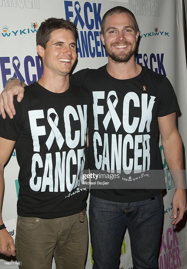Robbie Amell and Stephen Amell attend 2nd Annual F*ck Cancer Charity Event LA at Bootsy Bellows on May 9, 2013 in West Hollywood, California.