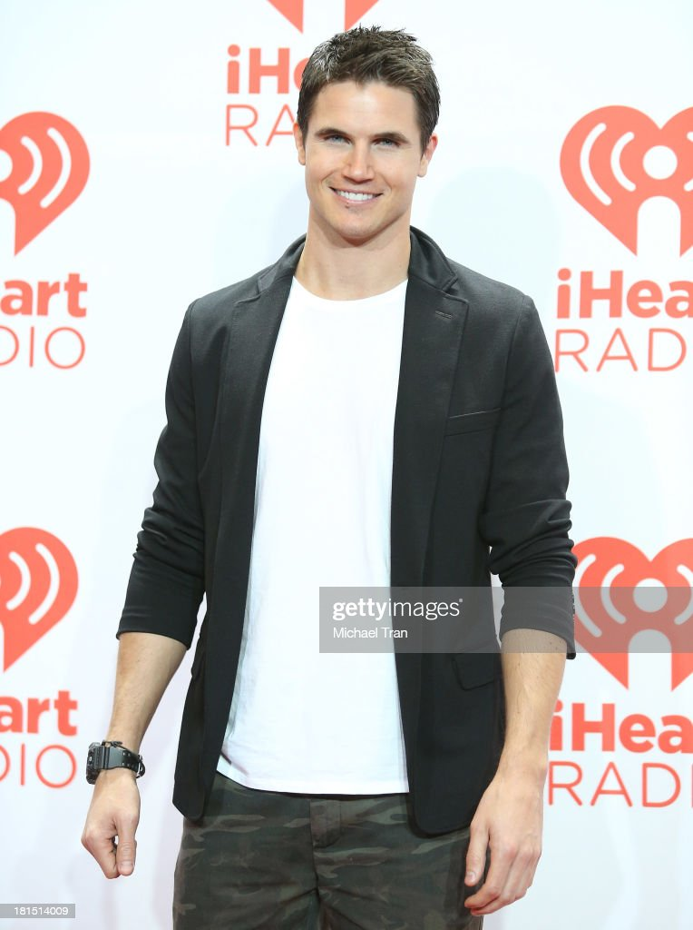 Robbie Amell arrives at the iHeartRadio Music Festival - press room - Day 2 held on September 21, 2013 in Las Vegas, Nevada.