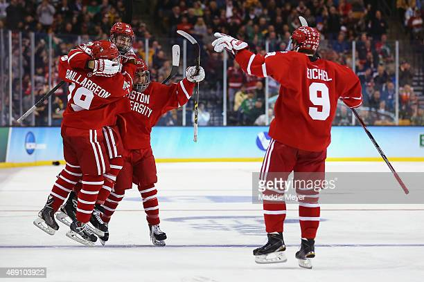 Robbie Baillargeon Brandon Fortunato and Jack Eichel congratulate AJ Greer of the Boston University Terriers after he scored against North Dakota...