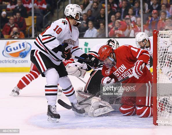 Robbie Baillargeon of the Boston University Terriers takes a shot against the Northeastern Huskies during the second period of the 2015 Beanpot...