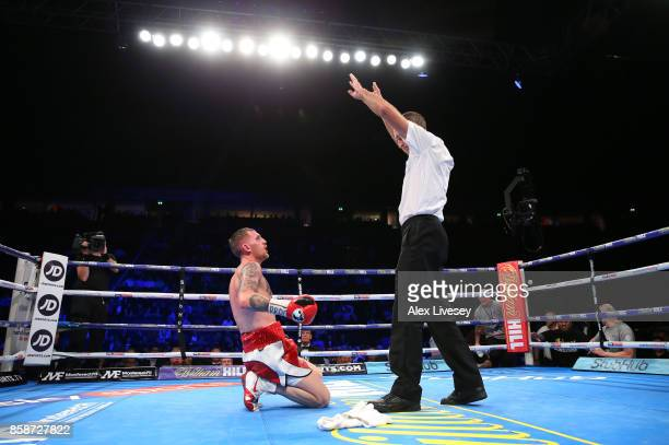 Robbie Barrett looks on as referee Steve Gray stops the fight after the towel is thrown in from his corner against Lewis Ritson during the British...