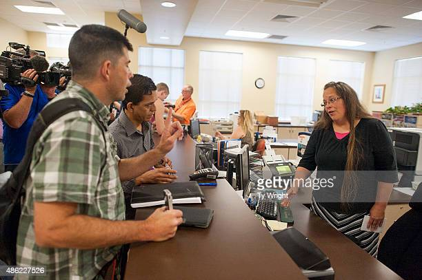Robbie Blankenship stands next to his partner of 20 years Jesse Cruz of Corpus Christie Texas as they try to get a marriage license from Rowan County...