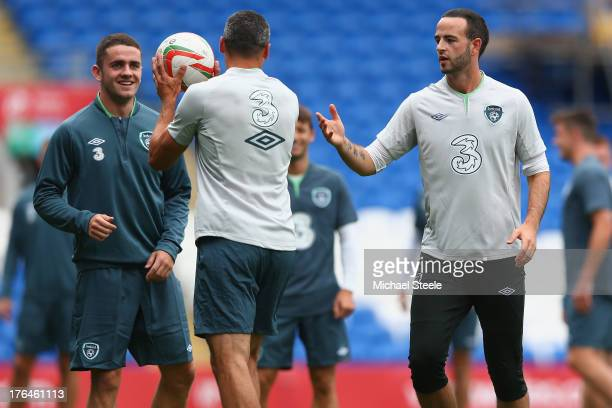 Robbie Brady Jonathan Walters and Marc Wilson during the Ireland training session at the Cardiff City Stadium on August 13 2013 in Cardiff Wales