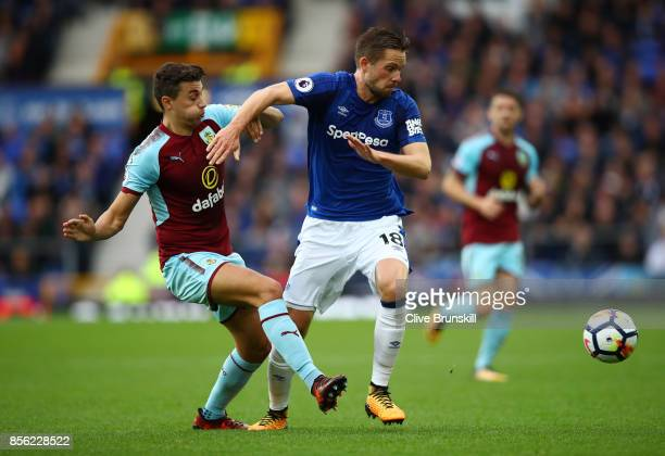 Robbie Brady of Burnley and Gylfi Sigurdsson of Everton battle for possession during the Premier League match between Everton and Burnley at Goodison...
