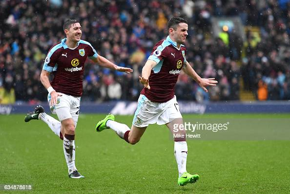 Robbie Brady of Burnley celebrates scoring his sides first goal with Stephen Ward during the Premier League match between Burnley and Chelsea at Turf...