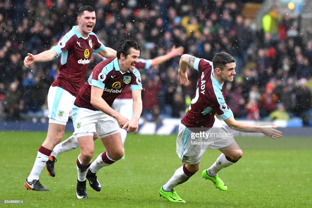 Robbie Brady of Burnley (R) celebrates scoring his sides first goal with Joey Barton during the Premier League match between Burnley and Chelsea at Turf Moor on February 12, 2017 in Burnley, England.