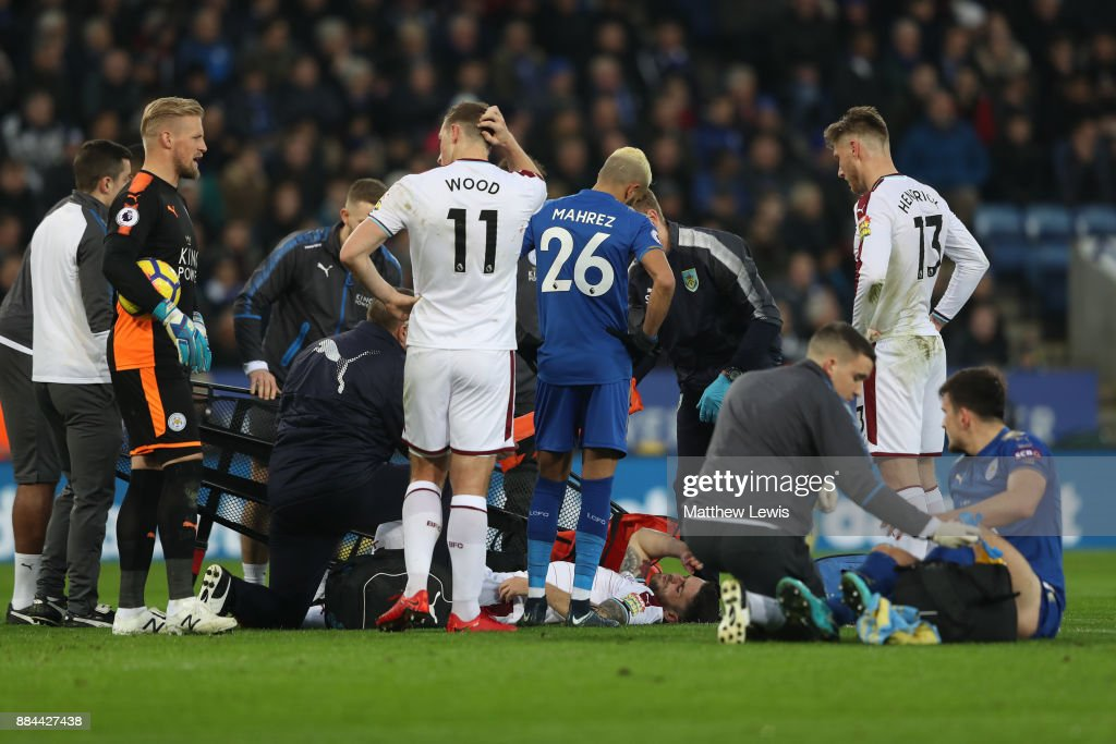 Robbie Brady of Burnley receives treatment from the medical team during the Premier League match between Leicester City and Burnley at The King Power Stadium on December 2, 2017 in Leicester, England.