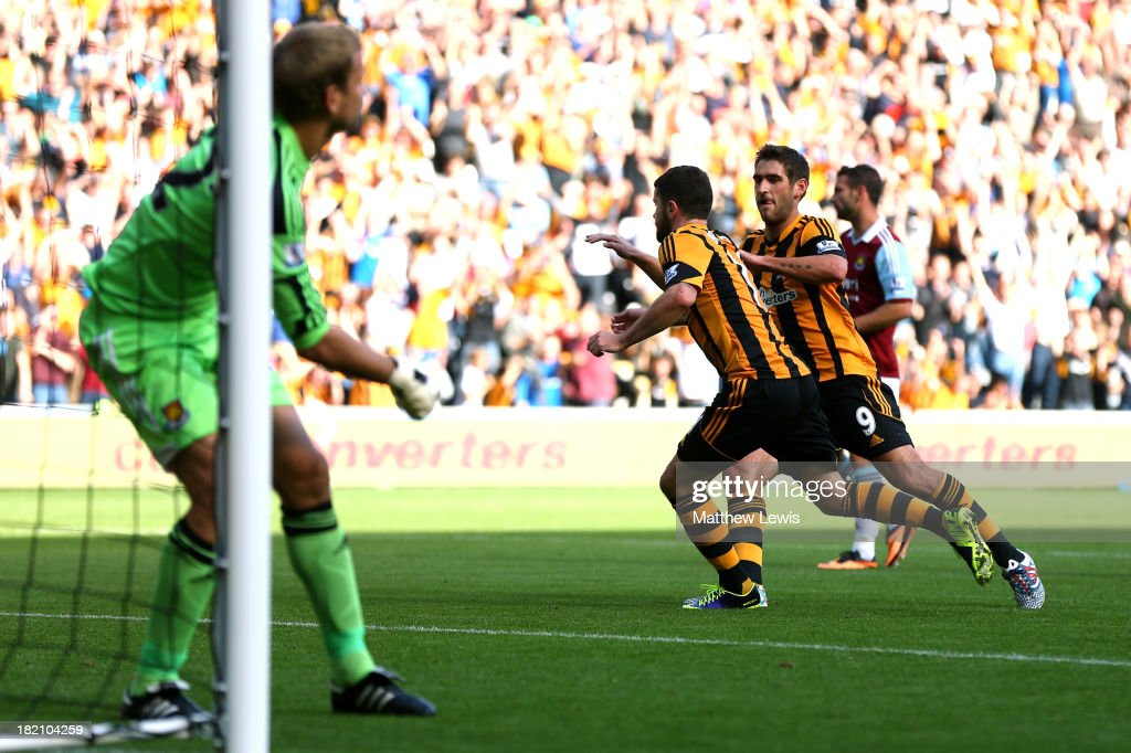Robbie Brady of Hull City is congratulated by teammate Danny Graham after scoring the opening goal from the penalty spot during the Barclays Premier...
