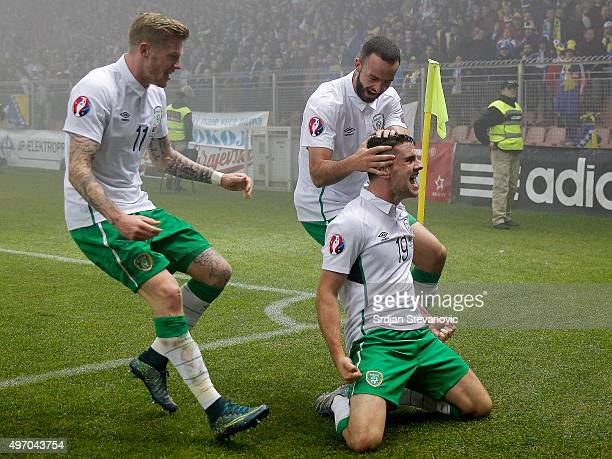 HERZEGOVINA NOVEMBER 13 Robbie Brady of Ireland celebrates scoring a goal with the teammates Marc Wilson and James McClean during the EURO 2016...