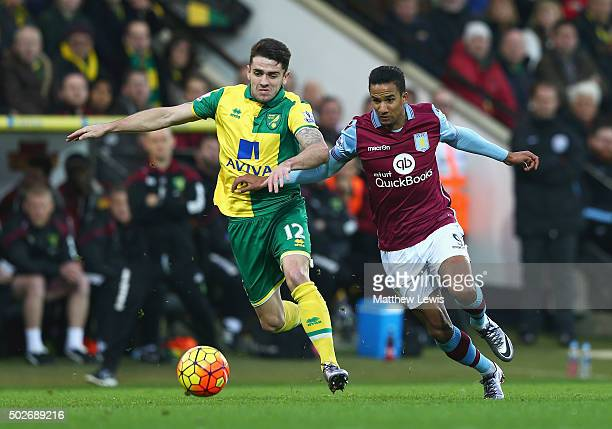 Robbie Brady of Norwich City and Scott Sinclair of Aston Villa compete for the ball during the Barclays Premier League match between Norwich City and...