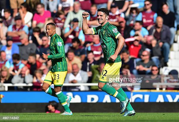 Robbie Brady of Norwich City celebrates scoring his team's first goal during the Barclays Premier League match between West Ham United and Norwich...
