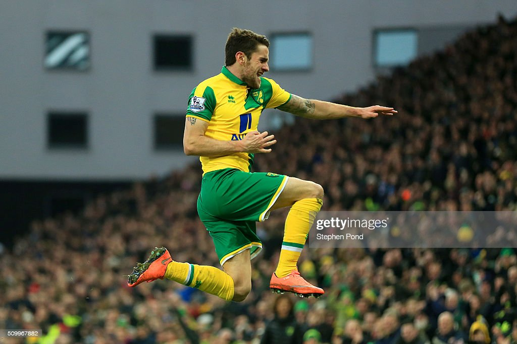 Robbie Brady of Norwich City celebrates scoring his team's first goal during the Barclays Premier League match between Norwich City and West Ham...