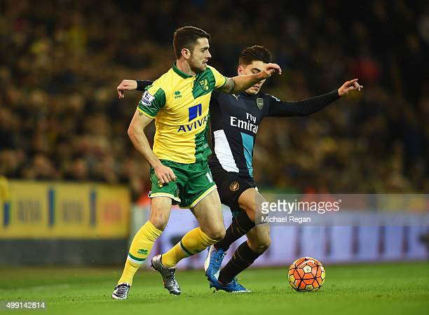 Robbie Brady of Norwich City takes on Hector Bellerin of Arsenal during the Barclays Premier League match between Norwich City and Arsenal at Carrow...