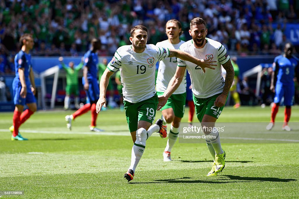 <a gi-track='captionPersonalityLinkClicked' href=/galleries/search?phrase=Robbie+Brady&family=editorial&specificpeople=9028769 ng-click='$event.stopPropagation()'>Robbie Brady</a> (C) of Republic of Ireland celebrates scoring the opening goal during the UEFA EURO 2016 round of 16 match between France and Republic of Ireland at Stade des Lumieres on June 26, 2016 in Lyon, France.