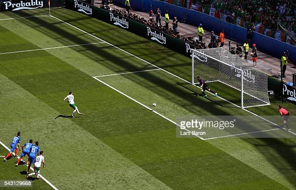 Robbie Brady of Republic of Ireland converts the penalty to score the opening goal past Hugo Lloris of France during the UEFA EURO 2016 round of 16...