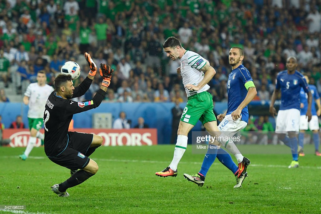 Robbie Brady of Republic of Ireland heads the ball to score the opening goal past Salvatore Sirigu of Italy during the UEFA EURO 2016 Group E match between Italy and Republic of Ireland at Stade Pierre-Mauroy on June 22, 2016 in Lille, France.